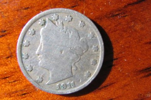 Example of a well-worn Liberty Head nickel from 1911, one of the later years of the Barber design.