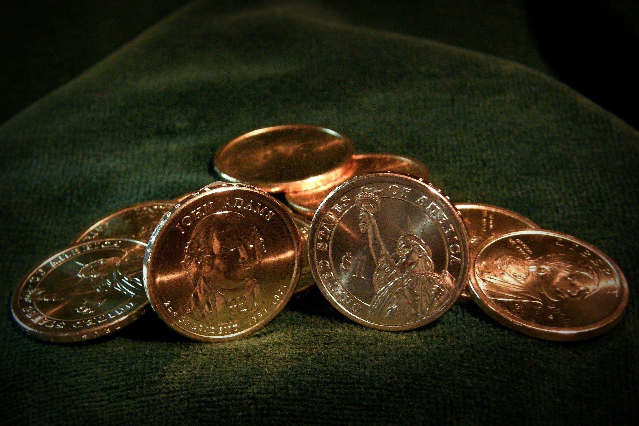How much is a John Adams dollar coin worth?