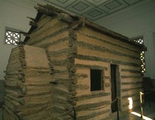 Abe-Lincoln-Log-Cabin-Birthplace-by-eoghanacht-on-Wikimedia-2.jpg