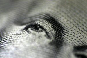 A closeup of the eyes on a one dollar bill