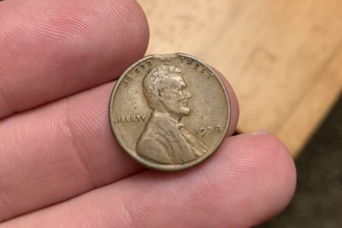 A clipped planchet penny. One cent planchet error coin