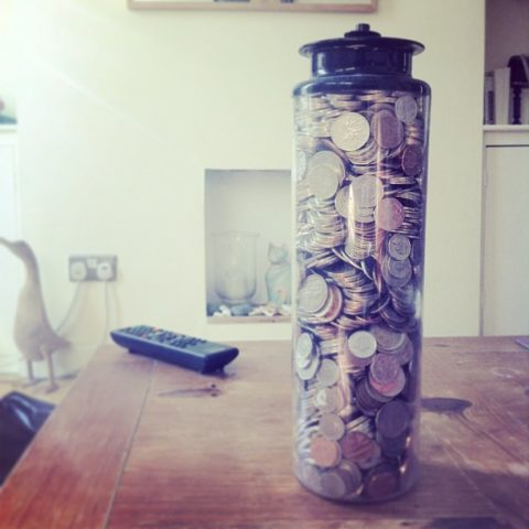 Collecting coins in a change jar
