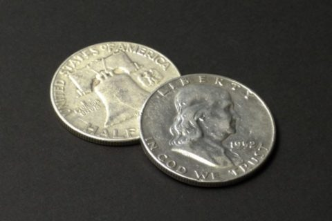 Franklin half dollar coins.
