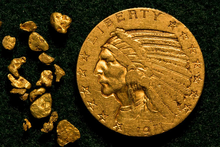 This is a 1911 Indian Head five dollar gold coin and golden nuggets.