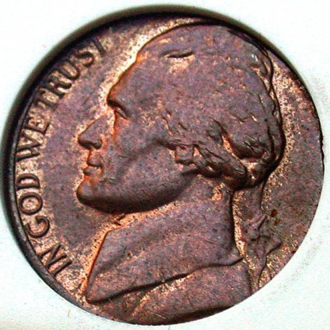 The wrong color is a sign that this is a nickel that was struck on a penny planchet.