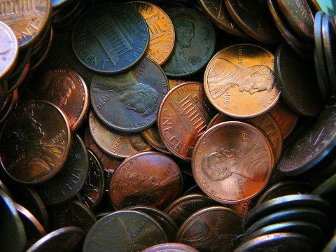 Lots of pennies and a few nickels in a loose change jar.