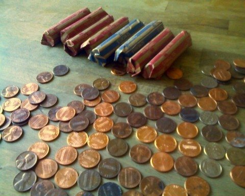 Searching through penny coin rolls.