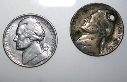 The 1943 Jefferson nickel has a common form of PMD -- Post Mint Damage -- a hole that wasn't there when the coin left the U.S. Mint.