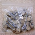 Several years' worth of silver coins -- mostly nickels -- in a ziploc bag.