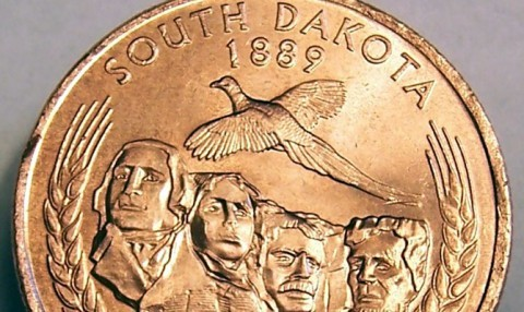 This is one of the 50 state quarters -- the South Dakota quarter. This error quarter is missing the extra layer of silver!