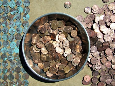 old pennies collecting dust in a penny jar