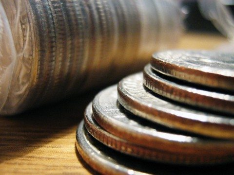 A stack of U.S. quarters symbolizes the U.S. Mint's release of the new America the Beautiful Quarters.
