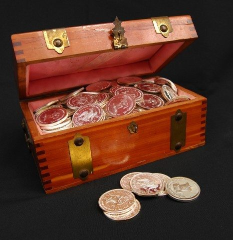 A treasure chest filled with silver coins